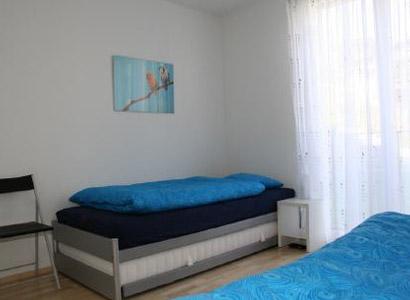 Ferienwohnung in Davos Schlafzimmer